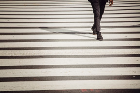 Picture of a black and white striped crosswalk