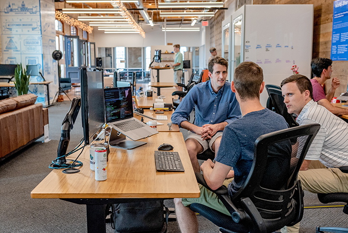 Team members collaborate in an office setting